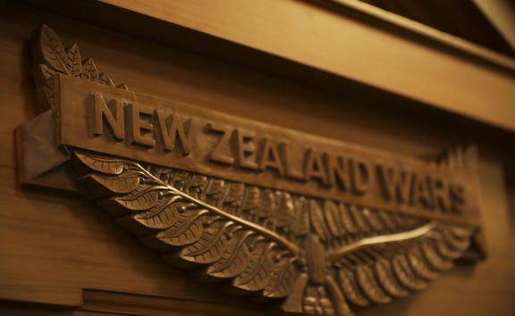 A plaque unveiled in Parliament, commemorating the New Zealand Wars.