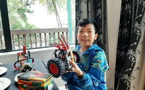 11 year old Ding Ding shows off his Lego creations.