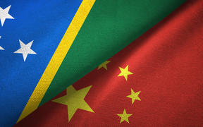 Solomon Island and China flags together
