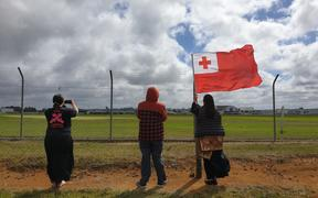 About 10 people gathered outside the base to watch as the plane took off.