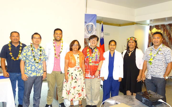 Marshall Islands President Hilda Heine, fourth from left, and Taiwan Ambassador Jeffery Hsiao, second from left, joined Ministry of Health staff and newly graduated doctors from Taiwan's I-Shou Medical University at a recent recognition event in Majuro