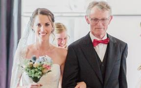 Melissa Hogenboom and her father Piet walking down the aisle on her wedding day