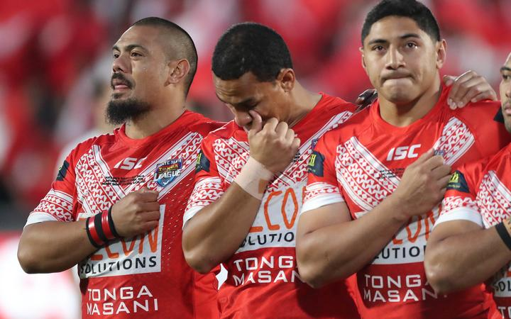Sika Manu, Will Hopoate and Jason Taumalolo during the Tonga national anthem prior to kickoff against the Kangaroos.