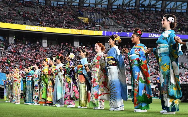 Performers in kimonos stand on the pitch of the Tokyo Stadium in Tokyo ahead of the Pool A opening match of the Japan 2019 Rugby World Cup between Japan and Russia on September 20, 2019. (Photo by Toshifumi KITAMURA / AFP)