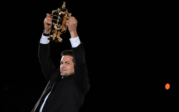 Former New Zealand international Richie McCaw holds the Rugby World Cup trophy during the tournament's opening ceremony at the Tokyo Stadium in Tokyo on September 20