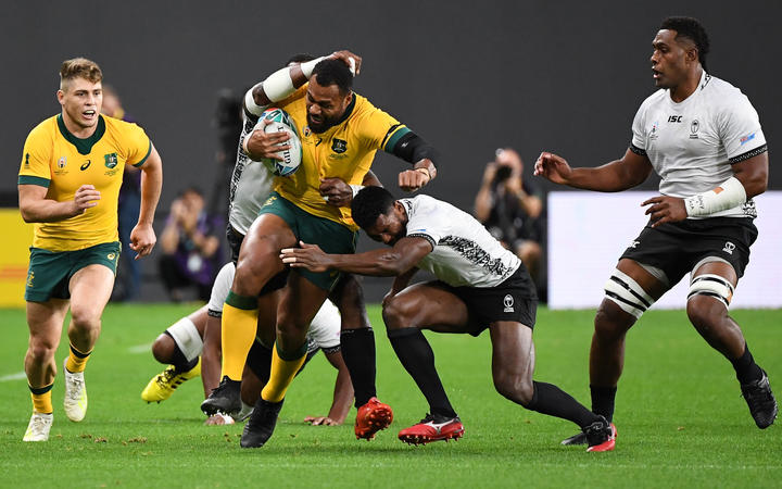 Fiji's scrum-half Frank Lomani tackles Australia's centre Samu Kerevi during the match between Australia and Fiji.