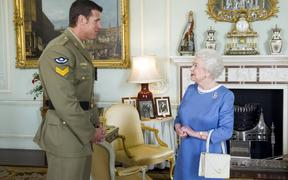 Britain's Queen Elizabeth (R) greets Australian Corporal Ben Roberts-Smith who was recently honoured with the Victoria Cross, during an audience at Buckingham Palace. (File)