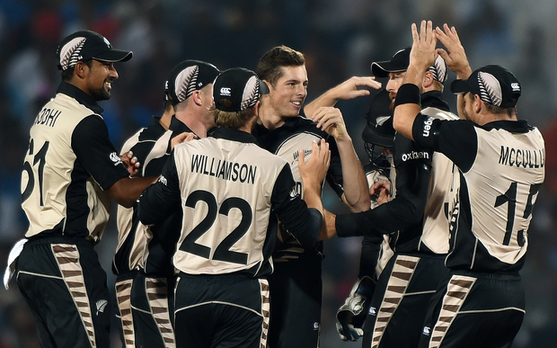 New Zealand bowler Mitchell Santner, centre, celebrates the wicket of India's Rohit Sharma during the World T20 match in Nagpur on 15 March 2016.