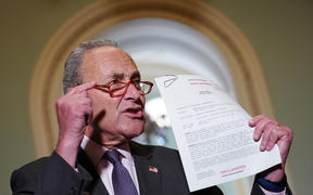 Senate Minority Leader Chuck Schumer (D-NY) speaks to reporters as he holds a transcript of the phone call between US President Donald Trump and Ukraine President Volodymyr Zelensky.