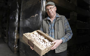 Clive Thompson, owner of Parkvale Mushrooms, with a box of his portobello mushrooms