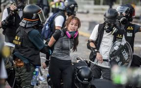 Police detain demonstrators in the Sha Tin district of Hong Kong as violent demonstrations take place in the streets of the city on the National Day holiday to mark the 70th anniversary of communist China's founding.