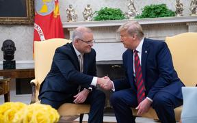 Scott Morrison and Donald Trump shake hands in the Oval Office during Morrison's official visit to White House last month.