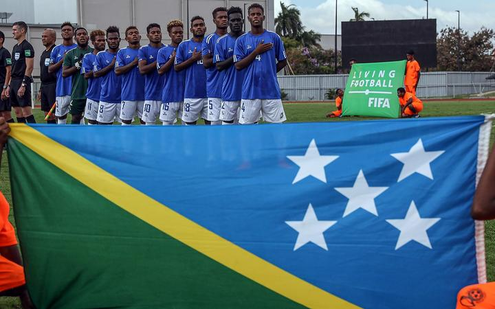Solomon players sing the anthem before their match against Vanuatu