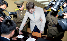 Otto Warmbier admitted stealing a propaganda sign during a trip to North Korea.