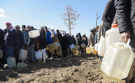 Refugees who fled the Iraqi city of Mosul due to the fighting between government forces and Islamic State, queue for heating fuel at the UN-run al-Hol refugee camp in Syria in 2017.