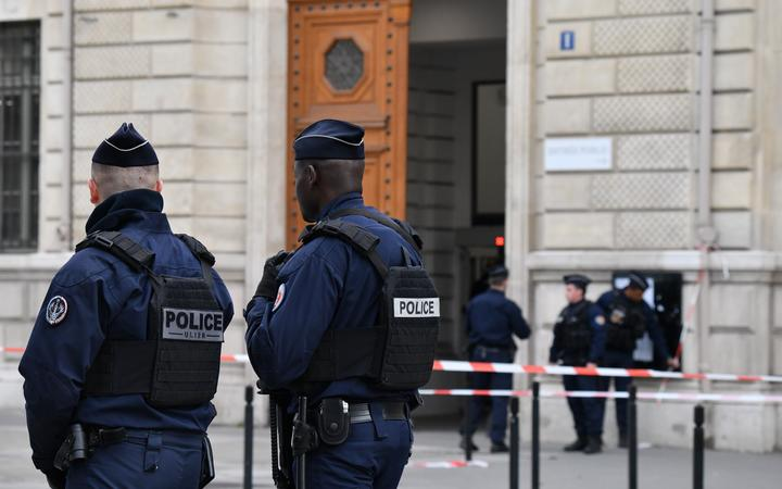Police and military personnel block the bridge near Paris Police headquarters after four officers were killed in a knife attack on October 3, 2019 in Paris, France.