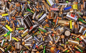 Many dead batteries gathered for recycling.