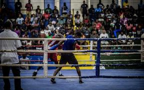 An amateur boxing match at the multi-purpose hall in Honiara.
