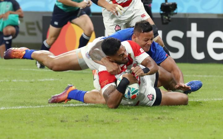 Timothy Lafaele of Japan tries in the first half of the Rugby World Cup Pool A match against Samoa at Toyota Stadium in Toyota City.