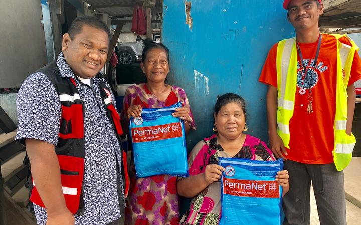 Red Cross volunteers have been active in distributing mosquito nets to residents in Ebeye (pictured) and Majuro as the dengue outbreak has continued for three months.