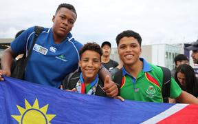 Kauaa Katjirua (l), Levalle Underhell (r) and friend at the New Zealand v Namibia game at Tokyo Stadium on Sunday