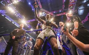 Israel Adesanya celebrates winning the UFC middleweight world title belt.