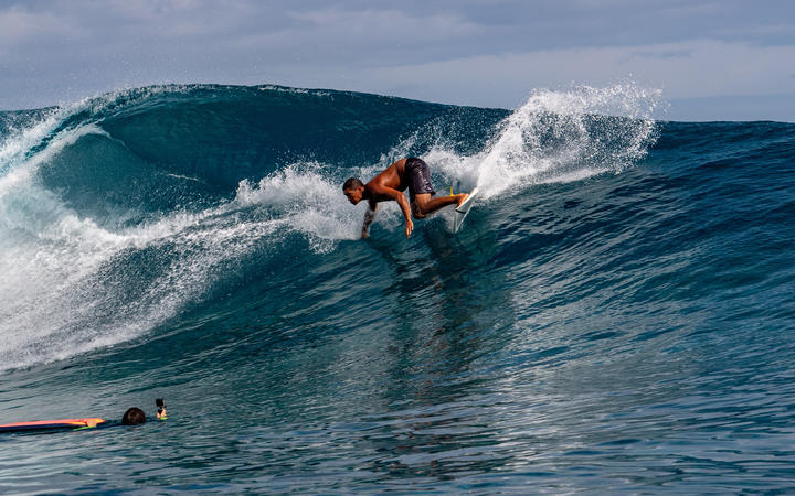 A Surfer training days out from Billabong's annual Tahiti competition at Teahupoo reef. TAHITI, FRENCH POLYNESIA - AUGUST 5 2018