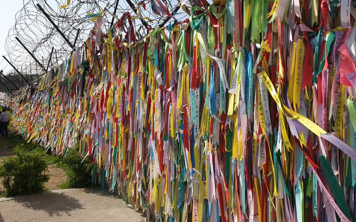 At the demilitarised zone in Korea, visitors leave messages of hope for a reunified peninsula.