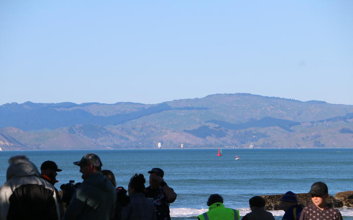 The Endeavour and the other tall ships sailed around past Te Kuri around 8am as onlookers gathered at Waikanae Beach to get a glimpse.