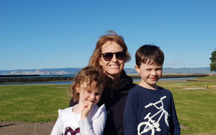 Sarah Guinness and her two children getting ready to watch the tall ships come in.