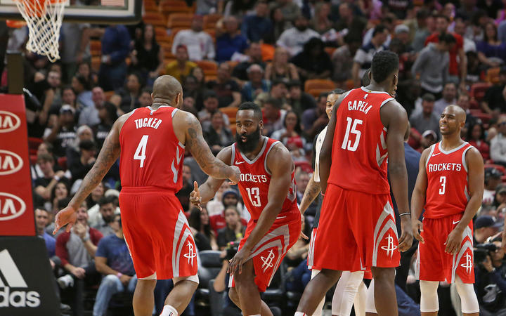 The Houston Rockets' James Harden (13) celebrates with teammates after a play during the fourth quarter against the Miami Heat in Miami, 7 February 2018