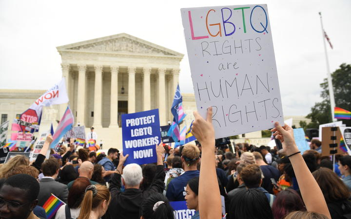 Demonstrators in favour of LGBT rights rally outside the US Supreme Court in Washington, DC, October 8, 2019, as the Court holds oral arguments in three cases dealing with workplace discrimination based on sexual orientation. (Photo by SAUL LOEB / AFP)