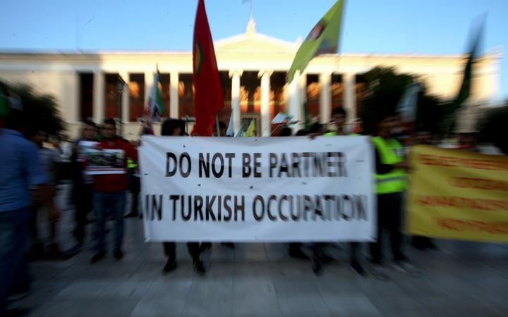 Kurds living in Athens protest near the Turkish Embassy against the Turkish offensive in northern Syria.