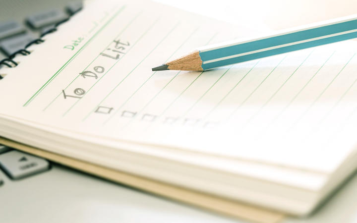 Handwritten to do list plan in a small note book. (File photo).