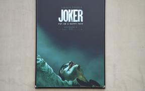 "A poster for the upcoming film ""The Joker"" is seen outside Warner Brothers Studios in Burbank, California, September 27, 2019."
