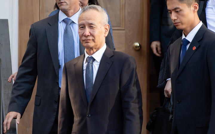 Chinese Vice Premier Liu He (C) departs during trade talks with the US Secretary of Treasury and US Trade Representative at the office of the US Trade Representative in Washington, DC, October 10, 2019.