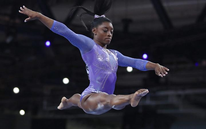 BILES Simone USA,winner, performs the final apparatus of Women's Balance Beam in the World Artistic Gymnastics Championships in Stuttgart, Germany on October 13, 2019. ( The Yomiuri Shimbun )