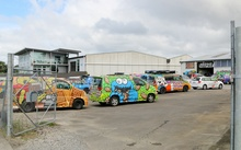 Wicked campervans parkedup at the company's yard.