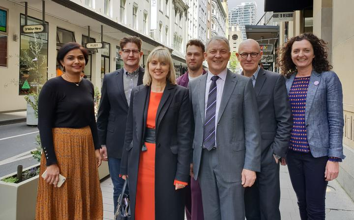 Mayor Phil Goff, Cr Chris Darby, Cam Perkins (design lead, Auckland Design Office), Viv Beck, Heart of the City chief executive and  High Street business owners.