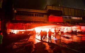 Firemen try to put out a fire inside a mall following a 6.4-magnitude quake in General Santos City, in southern island of Mindanao.