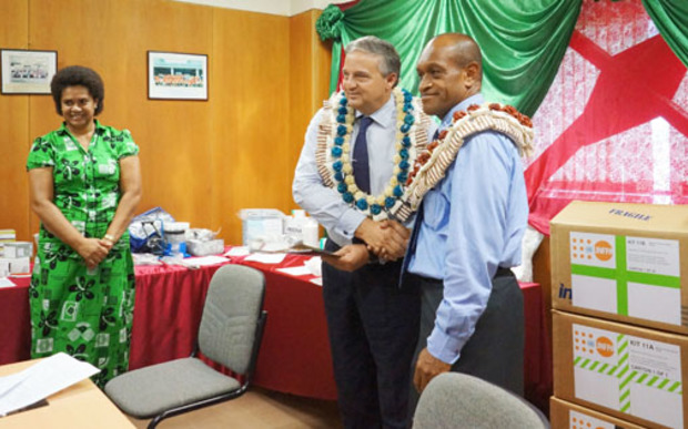 Fiji's health minister, Jone Usamate (right), and Dr Laurent Zessler of the UNPA (left).