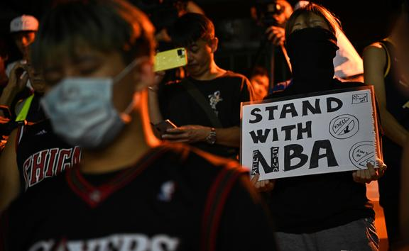A protester holds a sign at the Southorn Playground in Hong Kong on October 15, 2019, during a rally in support of NBA basketball Rockets general manager Daryl Morey and against comments made by Lakers superstar LeBron James.