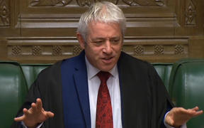 A video grab from footage broadcast by the UK Parliament's Parliamentary Recording Unit (PRU) shows Britain's Speaker of the House of Commons John Bercow officiates as Prime Minister Boris Johnson makes a statement in the House of Commons in London on October 19, 2019.