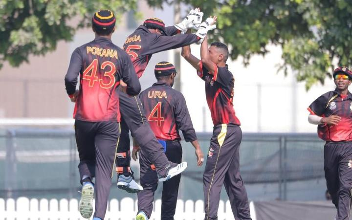 The PNG Barramundis celebrate a wicket.