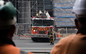 Firefighters gather around SkyCity convention centre where a fire has broken out.