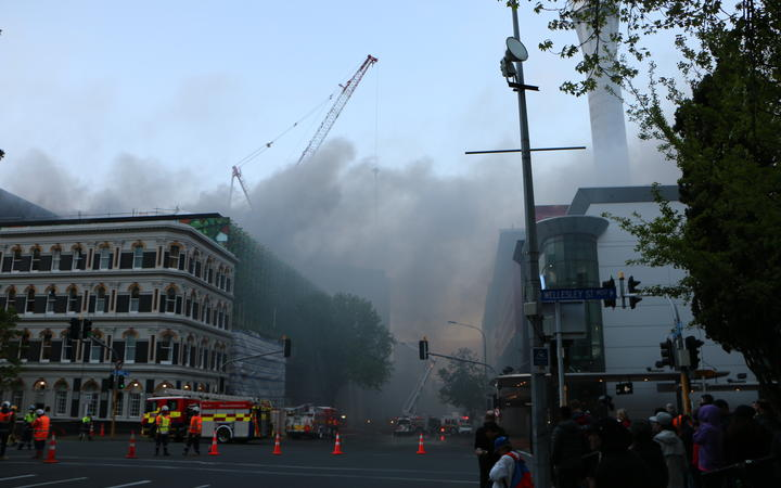 Smoke fills Auckland's CBD, where firefighters are battling a blaze at the SkyCity Convention Centre.