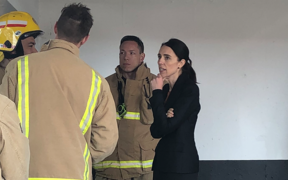 Prime Minister Jacinda Ardern talks to firefighters battling SkyCity blaze.