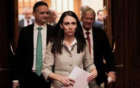 Prime Minister Jacinda Ardern, with Green party co-leader James Shaw, left) and Agriculture Minister Damien O'Connor prepare to announce the government's decision on agricultural emissions.