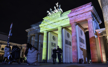 The colors of the Belgian flag are projected on to the Brandenburg Gate in Berlin as the German capital shows its solidarity following the Brussels attacks.