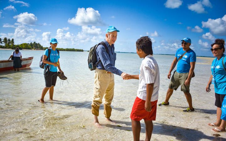 The UNICEF's rep in the Pacific, Sheldon Yett, meets school children on his arrival in north Tarawa, Kiribati.